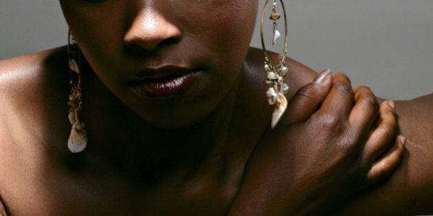 Portrait of young thoughtful African American woman, studio