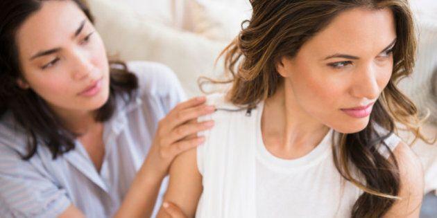 Hispanic woman comforting angry