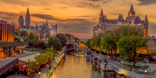 A summer evening in downtown Ottawa. This is the Rideau canal shot from the MacKenzie King Bridge.On...