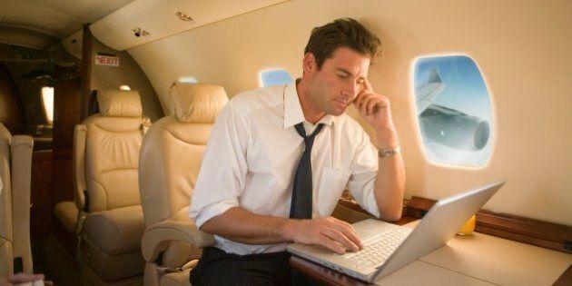 Businessman using laptop on