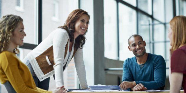 Smiling coworkers in meeting in modern