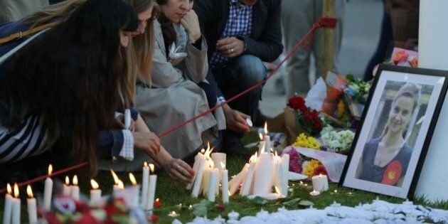 People light candles at the tributes in Parliament Square central London on June 17, 2016 in remembrance...
