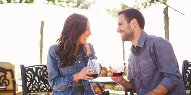 Couple enjoy glasses of wine at outdoor