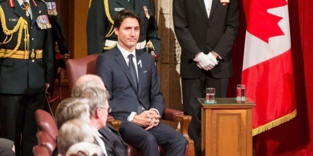 Prime Minister Justin Trudeau listens as Governor General David Johnston delivers the Speech from the...