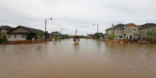 Home are still under water a week after major flooding hit High River, Alberta, June 29, 2013. Most of...