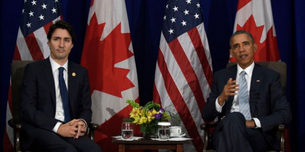 President Barack Obama, right, and Canada's Prime Minister Justin Trudeau, left, speak to reporters...