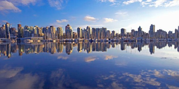 Canada, Vancouver apartment buildings reflecting in lake