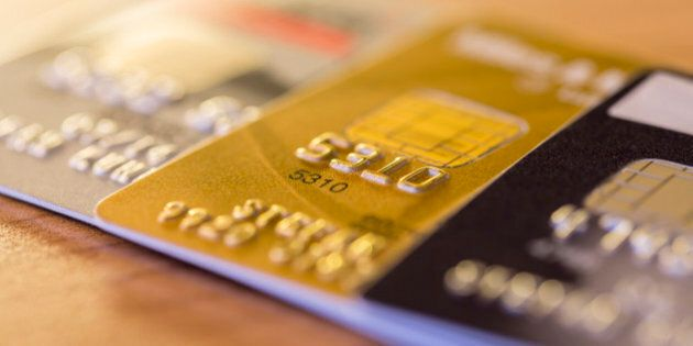 Cloesup view of credit cards in silver, gold and platinum black
