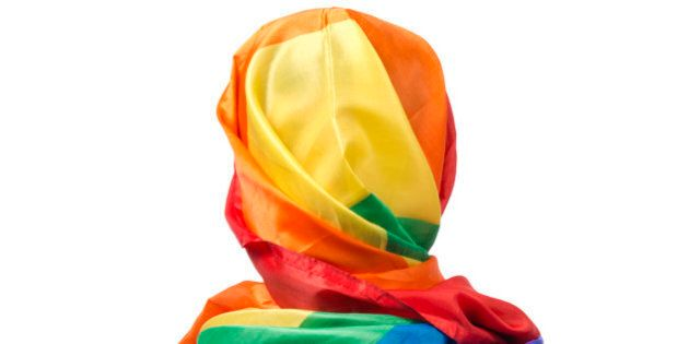 The human body wrapped in a gay flag which symbolises a muslim gay