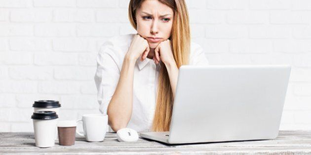 Young businesswoman having problems at