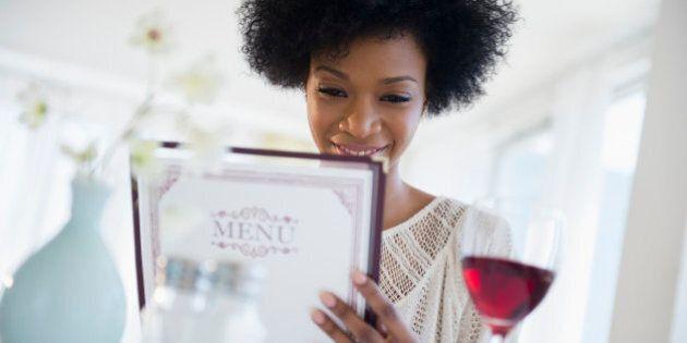 African American people reading menu at