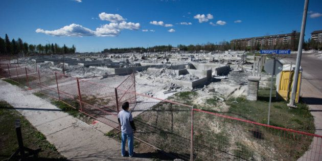 A resident surveys the damage of houses destroyed by wildfire in the Timberlea neighborhood of Fort McMurray,...