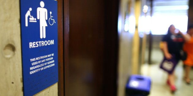 BOSTON, MA - MAY 25: The sign for the gender-neutral bathrooms on the 5th floor of Boston City Hall across from the reception area for the Mayor's office, May 15, 2016. The answer to the question of what restroom signs should say is not clear as transgender activists fight to use the facility that matches their identity. (Photo by John Tlumacki/The Boston Globe via Getty Images)