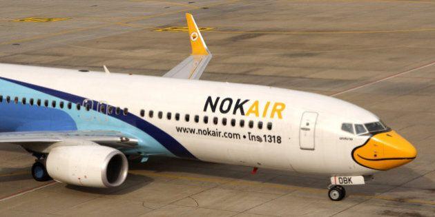 BANGKOK, THAILAND - 2013/07/25: A Nok Air air-plane parked at the terminal building at the Don Mueang...