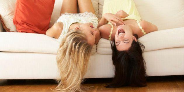 Two Female Friends Lying Upside Down On