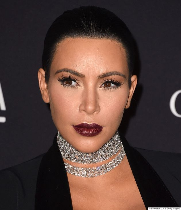 Kim Kardashian Showcases Her Very Pregnant Belly In Sheer, Lacy
