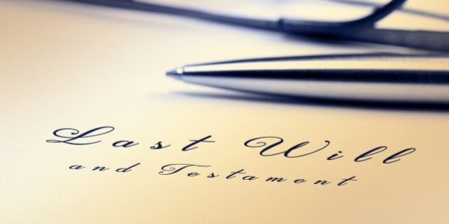 Last will and testament with pen and reading