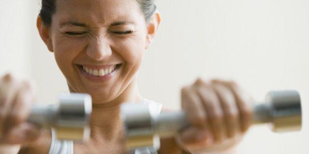 Hispanic woman exercising with