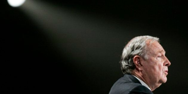 Former Prime Minister Paul Martin salutes the audience during a tribute to the former leader at the Liberal...