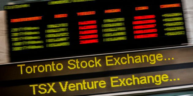 A sign board displaying Toronto Stock Exchange (TSX) stock information is seen in Toronto June 23, 2014....
