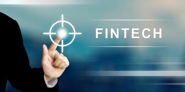 business hand pushing fintech or financial technology button on a touch screen
