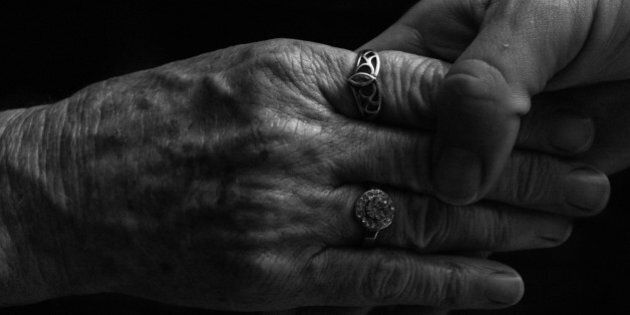 The young hands of a daughter softly holding the older hands of a mother,a precious bonding moment on Mothers Day.