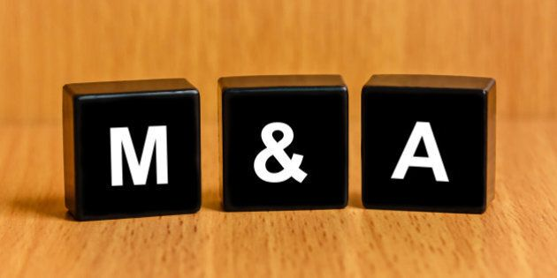 M&A or Merger and Acquisition text on black