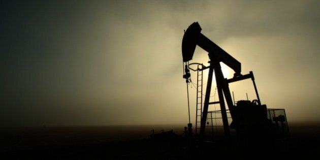 An oil lease pumpjack silhouette is contrasted against the