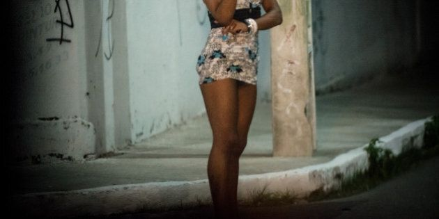 A prostitute stands along a street in Fortaleza, Ceara State, northeastern Brazil, on April 16, 2013....