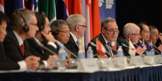 US Trade Representative Mike Froman (C) speaks at a press conference for the Trans-Pacific Partnership...