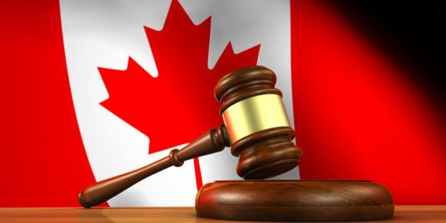 Law and justice of Canada concept with a 3d rendering of a gavel on a wooden desktop and the Canadian...