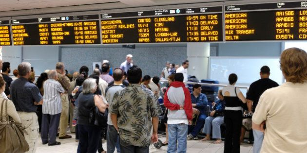 People waiting at arrivals hall of Toronto Pearson International airport. Ontario,