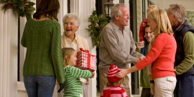 Family Greeting at Front Door for Christmas Party