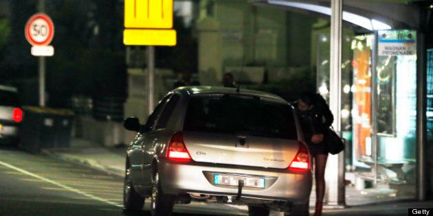 A prostitute speaks with a driver on March 28, 2013 in Nice, southern France. France's Senate will examine...