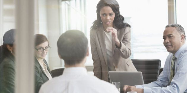 Businesswoman talking to colleagues in
