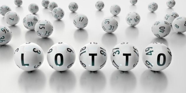Lotto Balls in front of white background writing the word LOTTO, cutout
