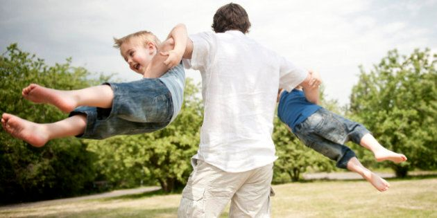 father spinning son's around in