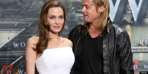 US actress Angelina Jolie (L) and US actor Brad Pitt arrive for the German premiere of the film 'World War Z' at the Cinestar movie theater in Berlin on June 4, 2013. The apocalyptic horror film based on the novel of the same name by Max Brooks is about a United Nations employee that travels around the world to save the planet from zombies. AFP PHOTO / ADAM BERRY (Photo credit should read ADAM BERRY/AFP/Getty Images)