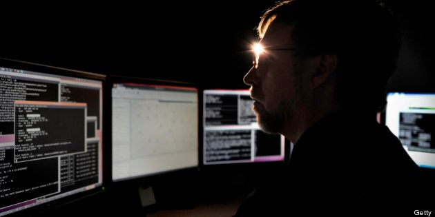 Joe Stewart, director of malware research at Dell SecureWorks, a unit of Dell Inc., works on multiple...