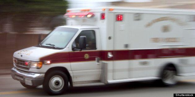 an ambulance blazes by