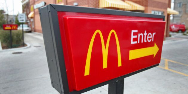 The McDonald's Corp. logo is displayed on a sign outside of a restaurant in Chicago, Illinois, U.S.,...
