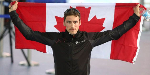 Sochi, Russia - February 15 - SSOLY- Canada's Denny Morrison earned a bronze and makes his way to the...