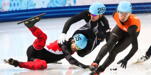 Sochi, Russia - February 15 - SSOLY- In the men's 1000m quarterfinals, Charles Hamelin crashes out in...