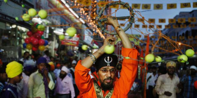 Indian Sikh devotees performs Sikh martial art during a religious procession Khalsa Saajna Divas or Baisakhi festival in Hyderabad, India, Friday, April 13, 2012. Baisakhi is the harvest festival widely celebrated in northern India, especially in the Punjab area. (AP Photo/Mahesh Kumar A.)
