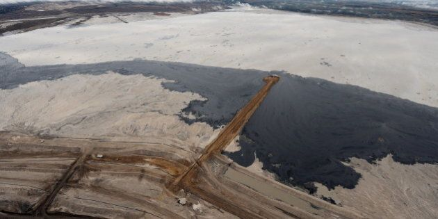 An aerial view of a tailings pond at the Suncor oil sands mine near the town of Fort McMurray in Alberta...