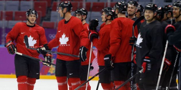 Canada forward Sidney Crosby, left, and other members of the Canadian men's ice hockey team wait at mid ice during a scoring drill during a training session at the 2014 Winter Olympics, Monday, Feb. 10, 2014, in Sochi, Russia. (AP Photo/Julie Jacobson)