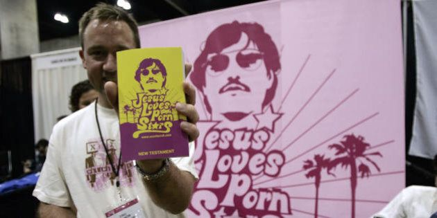Los Angeles, UNITED STATES:  Members of the XXXChurch a Christian-faith group distribute the 'bible' during the 10th Annual Erotica LA in Los Angeles Convention Center 23 June 2006. The Convention groups hundreds of adult entertainers, production companies, strip clubs and small bussineses that manufacture sex toys and other paraphernalia. AFP PHOTO / HECTOR MATA  (Photo credit should read HECTOR MATA/AFP/Getty Images)