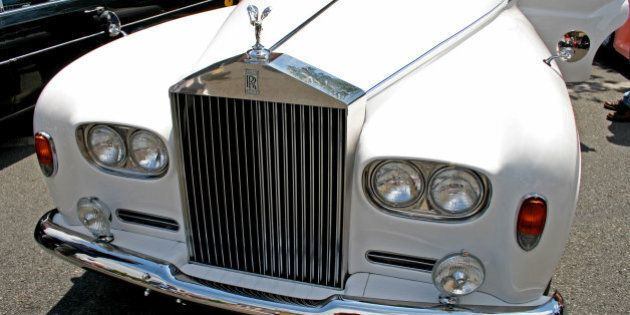 a classic car displayed at a...