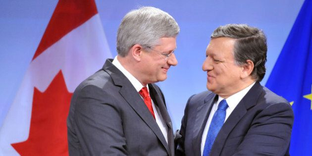 European Commission President Jose Manuel Barroso (R) shakes hand with Canadian Prime Minister Stephen...