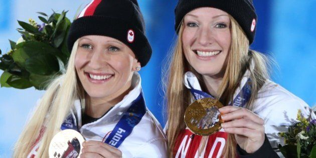 Canada's gold medalists pilot Kaillie Humphries and brakewoman Heather Moyse pose during the Women's...